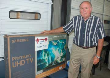 image of second grand prize winner receiving a flat screen TV