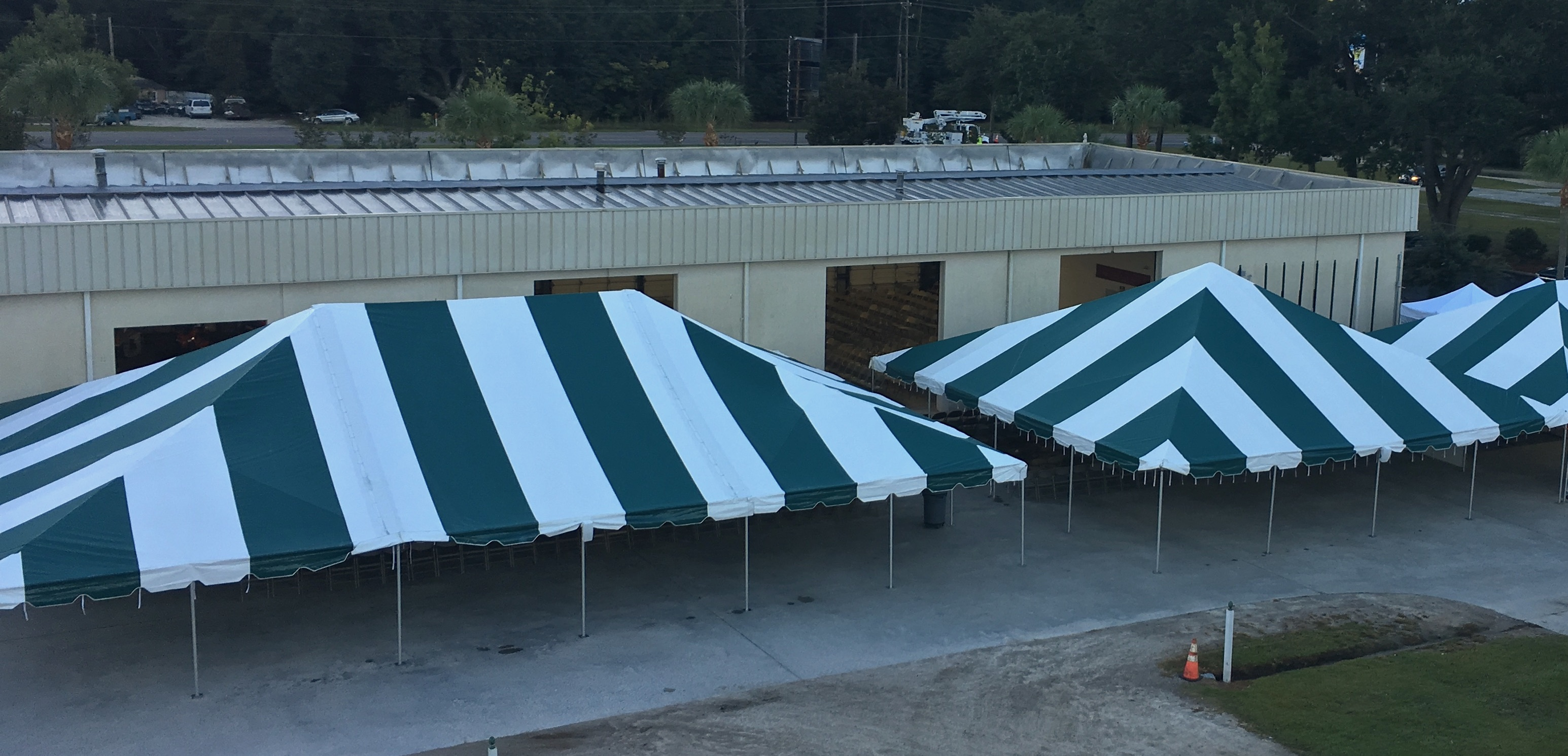 image of coop building with annual meeting tents set up