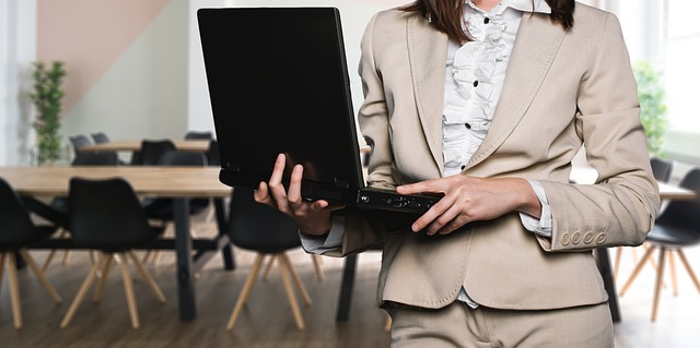 image of woman holding a laptop computer